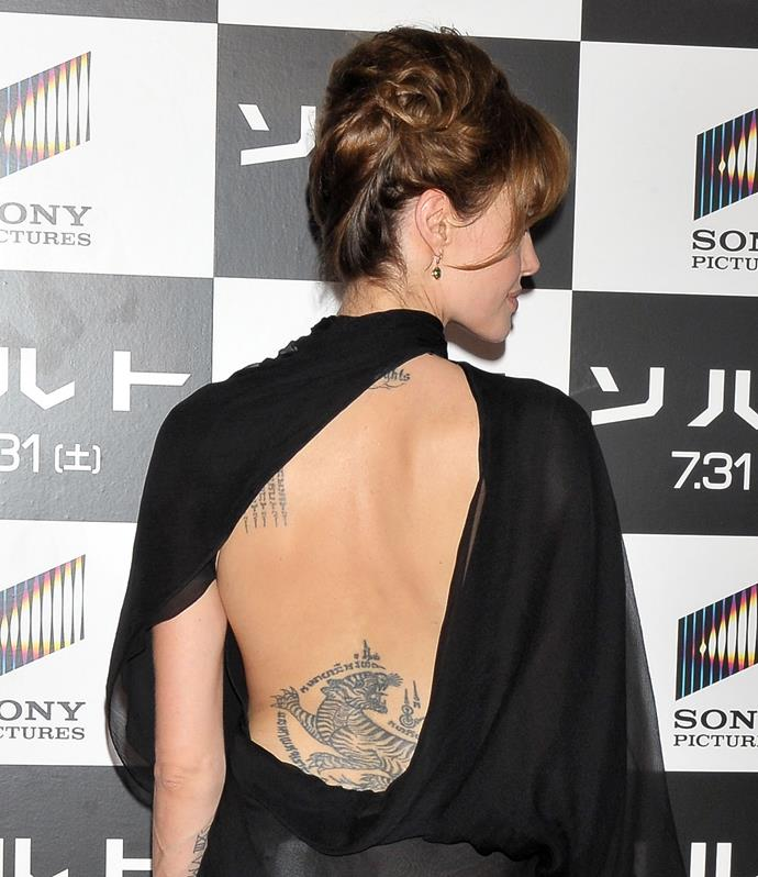 We are so used to seeing Angelina Jolie's upper back and bicep tattoos that we often forget about the massive tiger she has on her lower back.