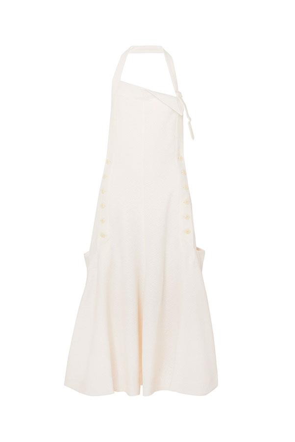 "Dress by Jacquemus, $1,998 at [Net-a-Porter](https://www.net-a-porter.com/au/en/product/1163068/jacquemus/tablier-open-back-textured-crepe-halterneck-dress|target=""_blank""
