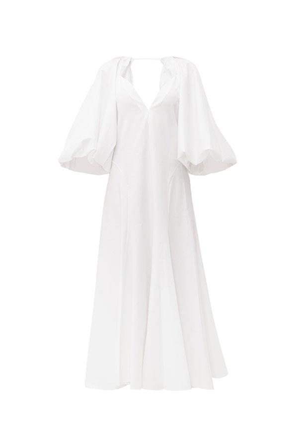 "Dress by Khaite, $2,552 at [MATCHESFASHION.COM](https://www.matchesfashion.com/au/products/Khaite-Joanne-balloon-sleeve-cotton-maxi-dress-1282427|target=""_blank""