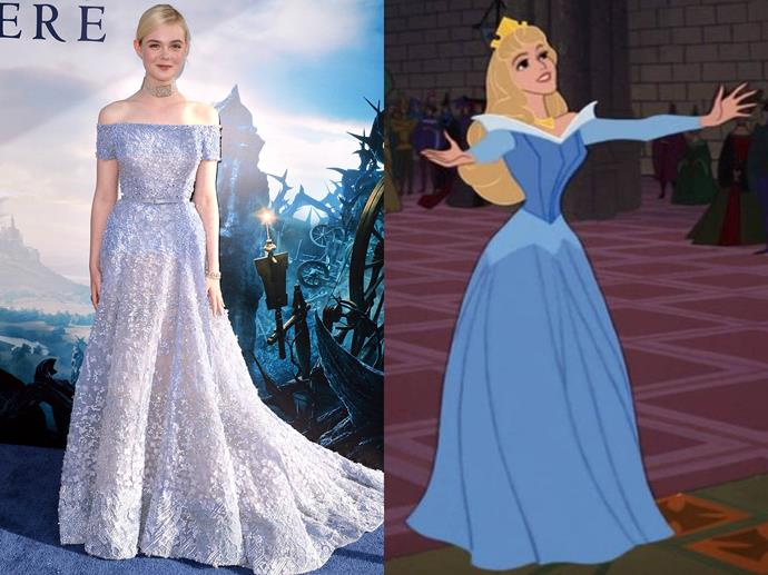 **Elle Fanning channelling Sleeping Beauty from** ***Maleficent***<br><br>  Inspired by Aurora's famous blue off-shoulder gown from the original *Sleeping Beauty* film, Elle Fanning wore a stunning Elie Saab couture gown to the film's premiere.