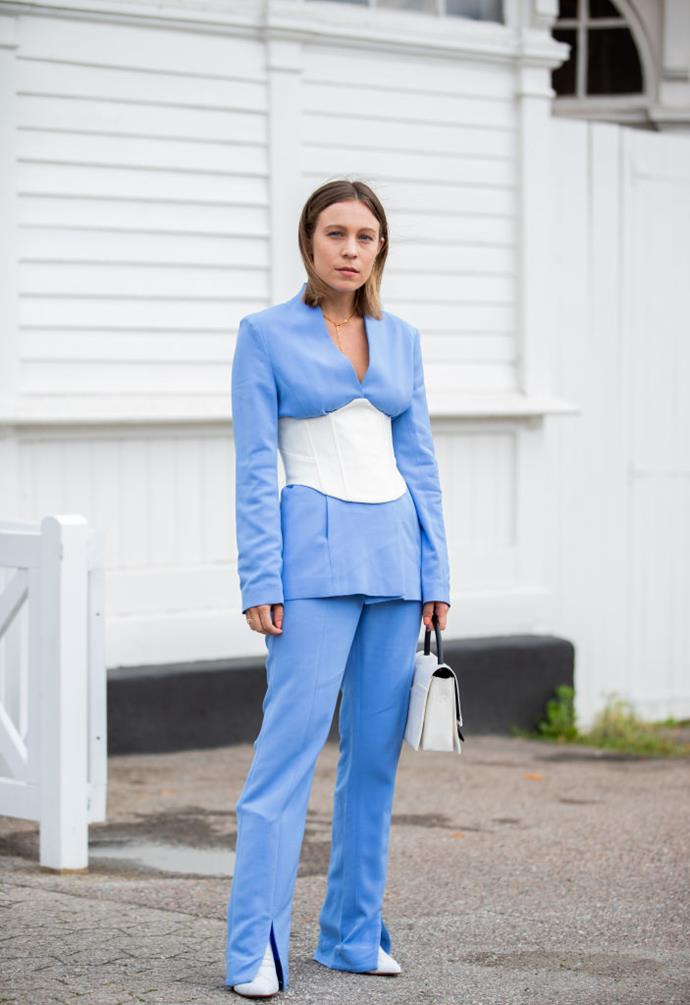 **Unexpected suiting** <br><br> If you're down for a major switch-up from a simple suit, now's the time to try something new, like this attendee's corset-inspired suit and trousers.