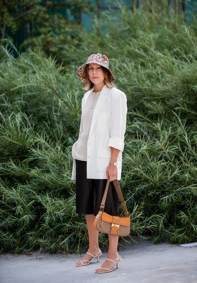 "**Bucket hats are back, too** <br><br> If your preferred style is monochromatic (in this case, a white blazer, black culottes, and [The Row](https://www.harpersbazaar.com.au/fashion/the-row-to-launch-shoe-line-9081|target=""_blank"") strappy sandals), don't be afraid to nab a vibrant bucket hat to liven up your look."