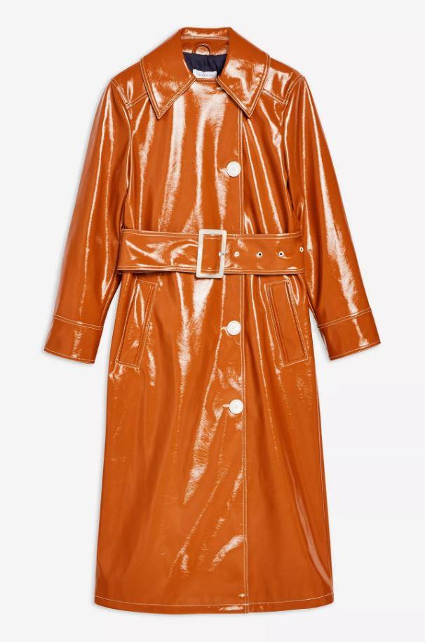 "*Tan vinyl trench coat by Topshop, $137 at [Topshop](https://www.topshop.com/en/tsuk/product/vinyl-trench-coat-8274060|target=""_blank""|rel=""nofollow"").*"