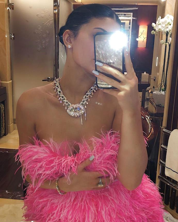 """Taking a quick selfie in one of her birthday dresses, plus her new necklace, which was a present from boyfriend Travis Scott.<br><br>  *Image via [@kyliejenner](https://www.instagram.com/p/B0_HGfXnovY/