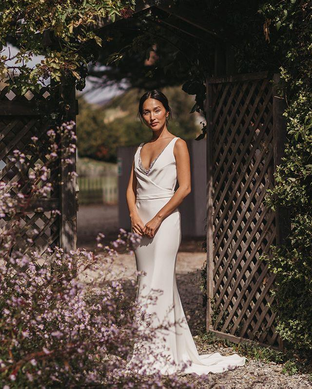 "**Nicole Warne** <br><br> For Warne's second reception, a post-wedding breakfast in Wanaka, New Zealand, she wore another silk gown by Australian designer Michael Lo Surdo, featuring subtle crystal embroidery on the V-neck. <br><br> *Image: Instagram [@nicolewarne](https://www.instagram.com/p/BhxY1efBXf5/|target=""_blank""