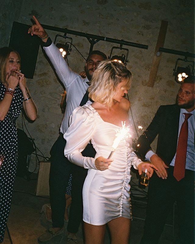 "**Anne-Laure Mais Moreau** <br><br> This French fashion blogger wore a stunning Magda Butrym party dress for her wedding reception in September 2018, which featured central ruching and long, billowing sleeves. <br><br> *Image: Instagram [@annelauremais](https://www.instagram.com/p/BndWPVjhdCD/|target=""_blank""
