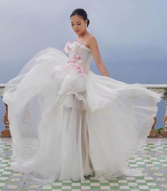 "**Feiping Chang** <br><br> Despite wearing Giambattista Valli Couture for her Italian wedding, Hong Kong-based blogger and It-girl Feiping Chang wore another equally effervescent gown by the Italian couturier for her reception, featuring silk petals weaved into the front. <br><br> *Image: Instagram [@xoxofei](https://www.instagram.com/xoxofei/|target=""_blank""