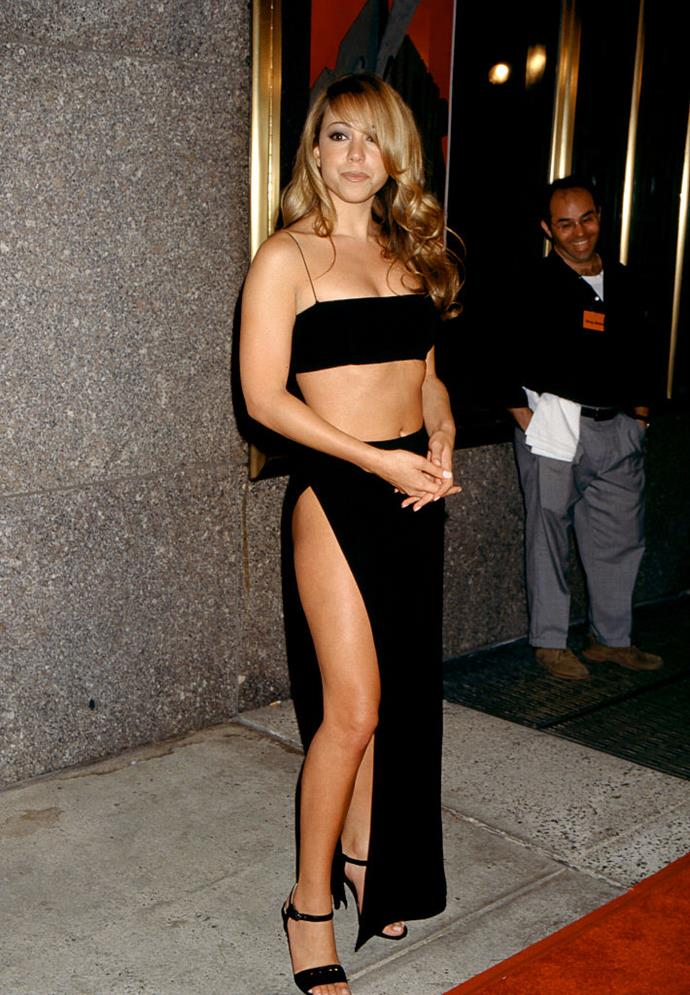 """**Mariah Carey in a black two-piece set in 1997**<br><br>  Although it may not seem particularly controversial now, Mariah Carey's two-piece """"revenge"""" look was widely considered one of the [most shocking dresses of the '90s](https://www.harpersbazaar.com.au/fashion/controversial-dresses-1990s-19093