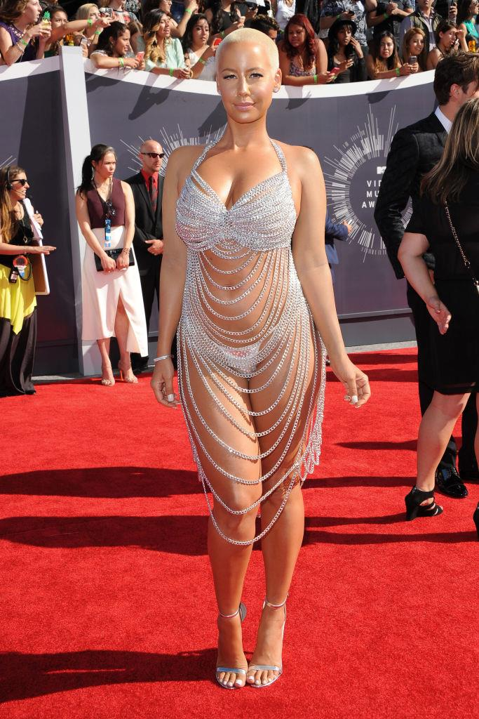 **Amber Rose's naked dress in 2014**<br><br>  Amber Rose appeared to be pay tribute to Rose McGowan's 1998 look in a barely-there naked dress by Laura Dewitt.