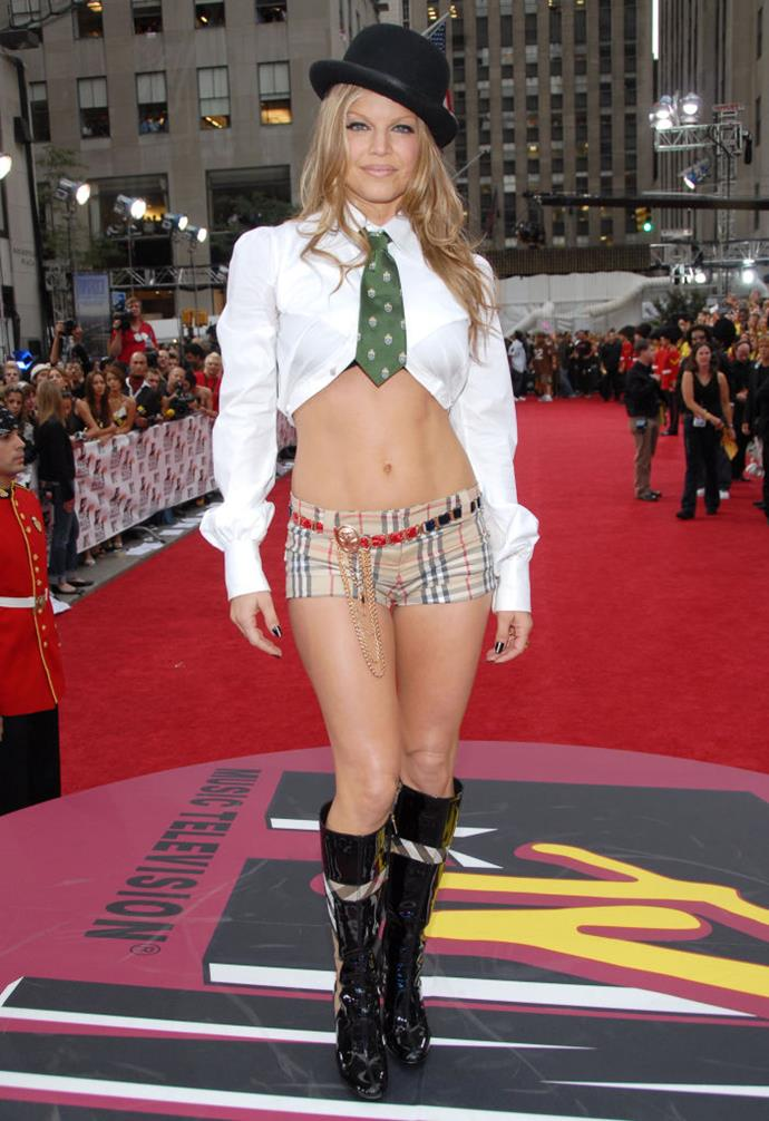 """**Fergie's """"London"""" look in 2006**<br><br>  Fergie's London-inspired album *The Duchess* dropped in 2006, which could explain the bizarre nod to the English capital in her red carpet look that year."""