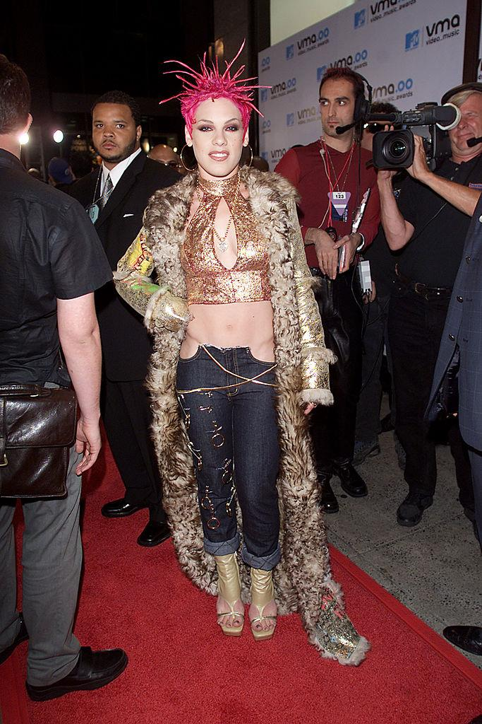 **Pink's sea urchin-inspired hair and jeans look in 2000**<br><br>  Sea urchin-inspired hair? Check. Metallics AND denim? Double check. Pink's 2000 red carpet look isn't one we're going to forget any time soon.