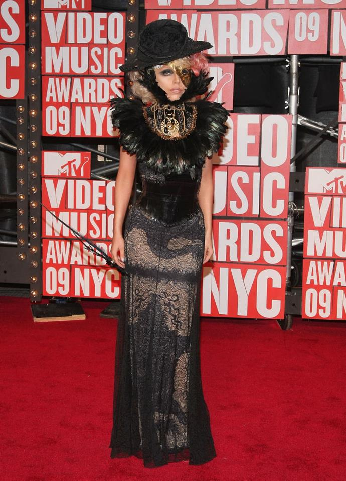 **Lady Gaga in lace and feathers in 2009**<br><br>  2009 marked Lady Gaga's first (epic) appearance at the major awards show, and she certainly did not disappoint.