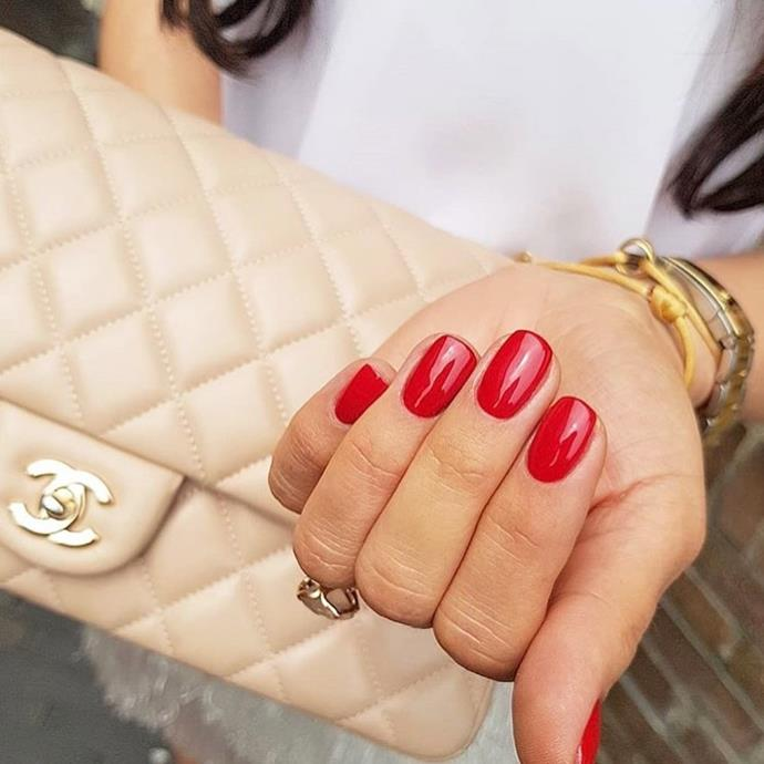 """**Scorpio:** ***Big Apple Red***<br><br>  Magnetic, secretive and sensual, Scorpios will look amazing sporting rich red nails that speak to their wild side.<br><br>   *Image via [@opi_gelcolor_](https://www.instagram.com/opi_gelcolor_/