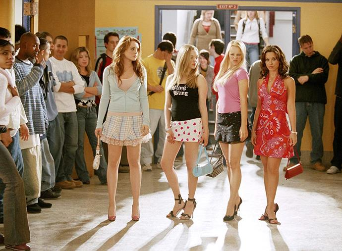 **The entire cast of *Mean Girls* (2004)** <br><br> Yes, *Mean Girls* is dated nowadays, but we can't deny the impact it had on us as young, impressionable adolescents. <br><br> From Britney Spears-style graphic tees (i.e. Karen Smith's 'Bling Bling' tee, pictured) to pint-sized pleated skirts and multicoloured monogram LV bags, *Mean Girls* truly had it all when it came to quintessential '00s fashion.