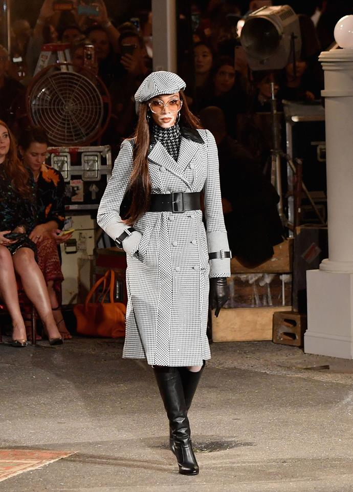 **The show had a stellar cast**<br><br>  Winnie Harlow walked the runway in a belted coat and beret combination.