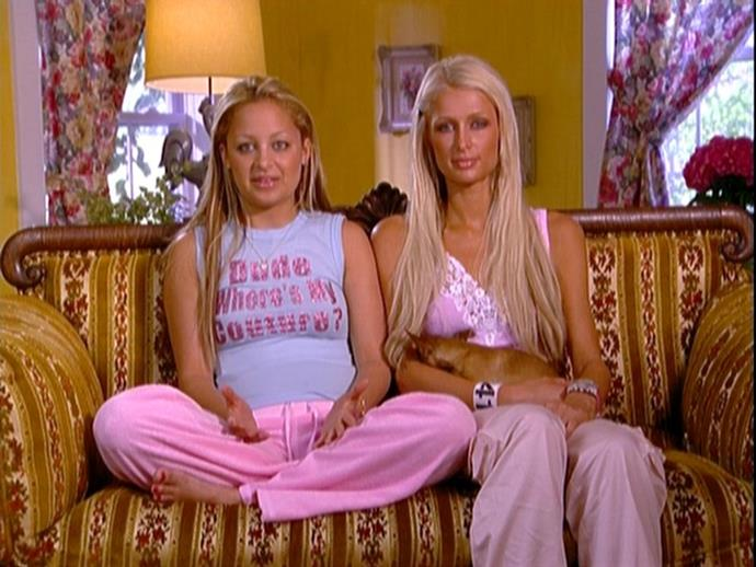 """**Paris Hilton and Nicole Richie in *The Simple Life* (2003—2007)** <br><br> If we're talking 2000s trends, Paris Hilton and Nicole Richie mastered the bulk of them—from unintentionally hilarious slogan tees, to Juicy Couture tracksuits, and jeans that sat so low on the hipbone, they defied gravity by staying in place. <br><br> Paris and Nicole were goals in 2003, so their modern-day style resurgence (by way of must-follow Instagram account *[@shesvague](https://www.instagram.com/shesvague/