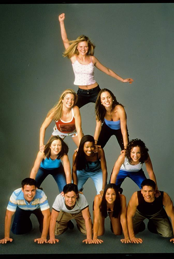 **The entire cast of *Bring It On* (2000)** <br><br> When *Bring It On* hit theatres in 2000, everyone wanted to become cheerleaders, and rightfully so. <br><br> As well as being a melting pot of 2000s beauty trends (high pony tails forever!), *Bring It On* helped force the resurgence of crop tops and miniskirts for the rest of the decade, with help from Gabrielle Union and teen movie queen Kirsten Dunst.