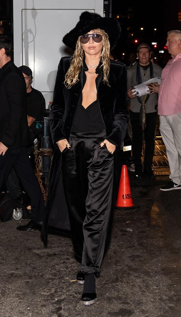 "A day prior, Cyrus attended Tom Ford's spring/summer '20 show at [New York Fashion Week](https://www.elle.com.au/new-york-fashion-week/new-york-fashion-week-street-style-day-6-7-14367|target=""_blank""), and wore satin trousers and a velvet coat, paired with one of the designer's furry hats. <br><br> *Image: Getty*"