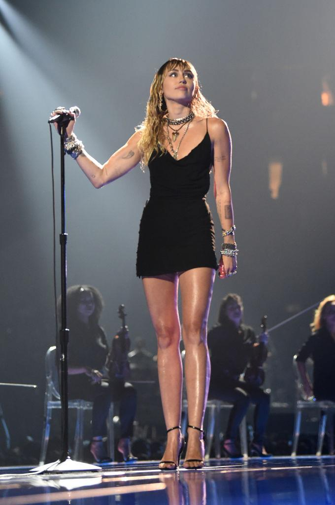 "Cyrus kept it simple in a low-cut black mini-dress and open-toed heels for her emotional performance of her song '[Slide Away](https://www.elle.com.au/celebrity/miley-cyrus-slide-away-lyrics-liam-hemsworth-21063|target=""_blank"")' at the 2019 [MTV VMAs](https://www.elle.com.au/fashion/vmas-red-carpet-2019-21123