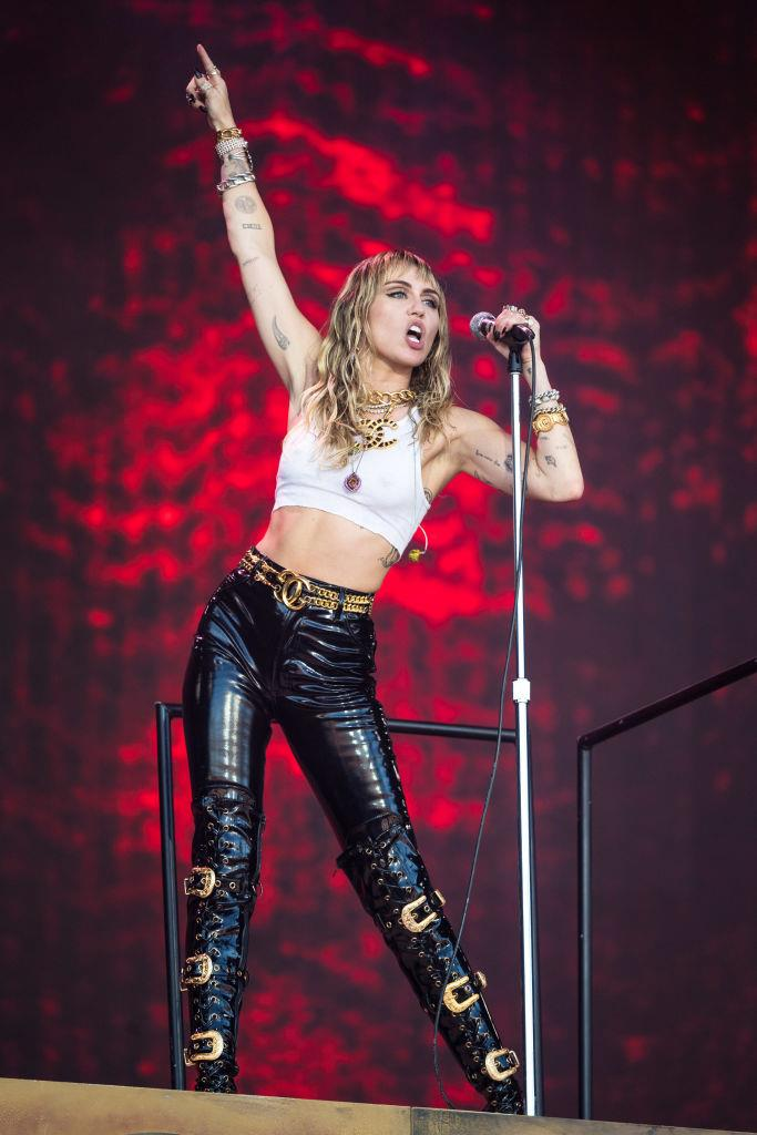 Two months before the split, Cyrus performed at Glastonbury Festival on June 30, 2019 in skin-tight latex pants and thigh-high Versace boots. <br><br> *Image: Getty*