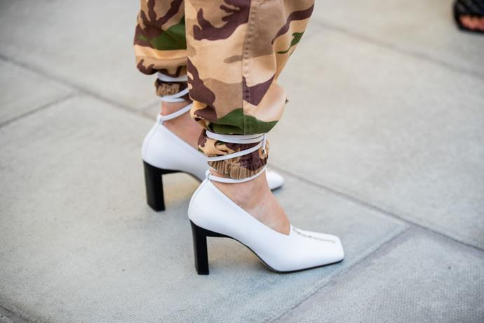 ***Trend three: the strappy heel shoes-over-pants trend*** <br><br> The strappy shoes-over-pants trend is a go-to trend for many show attendees this season—seen here at London Fashion Week on September 15, 2019. <br><br> *Image: Getty*