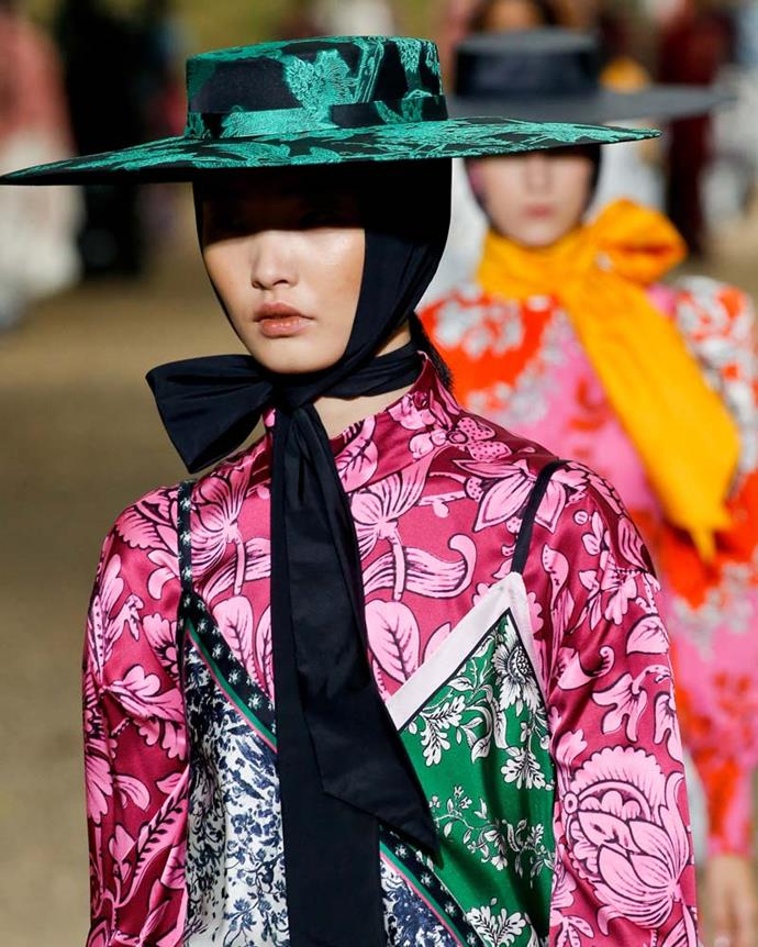 ***An OTT ribbon***<br><BR> There's always been something striking about the thin straw hat, but the addition of the thick ribbon under the chin—seen here at Erdem—makes it extra chic.