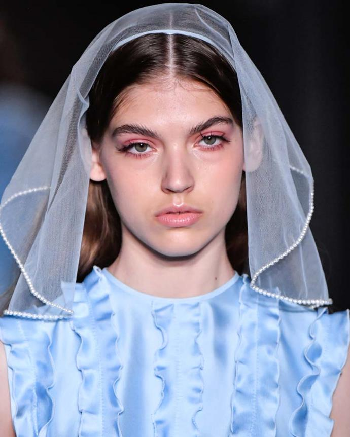 ***An embellished veil***<Br><br> We know what you're thinking: *here comes the bride.* Of course, veils have (and likely always will have) bridal vibes, but a slew of shows (including Huishan Zhang, pictured) used them as whimsical toppers for day looks. We're converts.