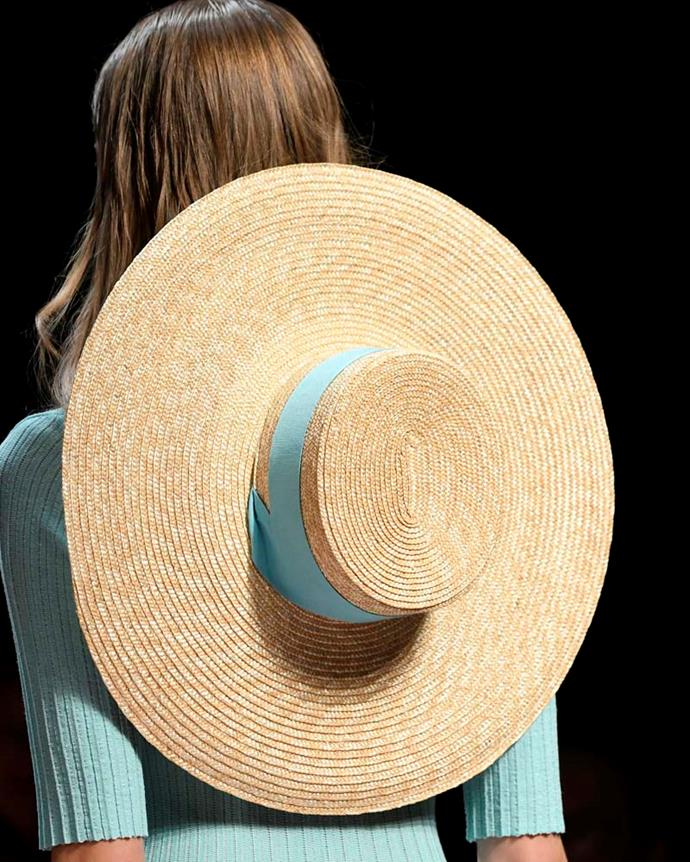 ***A boater worn behind your head***<br><br> While boaters definitely fall into the 'traditional headwear' realm, this styling trick might pass muster. Tie the ribbon around your neck and wear the hat hanging behind your neck for the ultimate 'French countryside vacation' vibe.