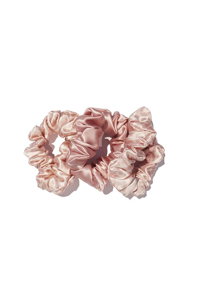 "***A stack of scrunchies***<br><br> Scrunchies (set of three), $50 by [Slip](https://www.slip.com.au/collections/hair-accessories/products/slip-scrunchies-pink-snow-leopard|target=""_blank""