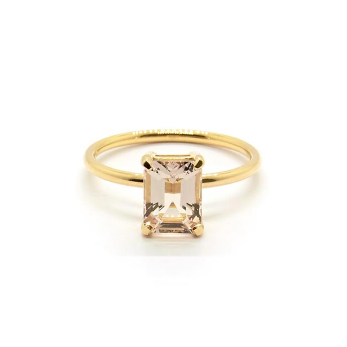"Morganite and yellow-gold ring, $1,510 by [Natalie Marie Jewellery](https://www.nataliemariejewellery.com/products/precious-emerald-cut-morganite-ring|target=""_blank""