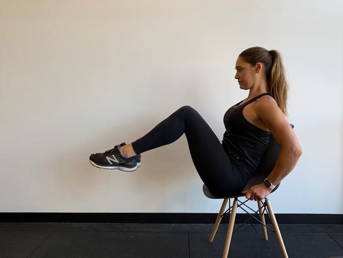**Seated Reverse Jack Knives**<br><br>  Sit on the edge of your chair, then lean your torso back whilst extending legs out in front of you. Then, tuck up into a crunch, extend back out and repeat.<br><br>  *Complete 15 reps*