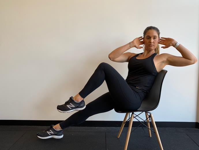 **Seated Bicycle Crunches**<br><br>  Sit on the edge of chair and place your hands behind your head. Slowly lean your torso back towards the chair, and then extend opposite leg to elbow back, and draw the other knee and elbow together like a bicycle motion.<br><br>  *Complete 20 reps*