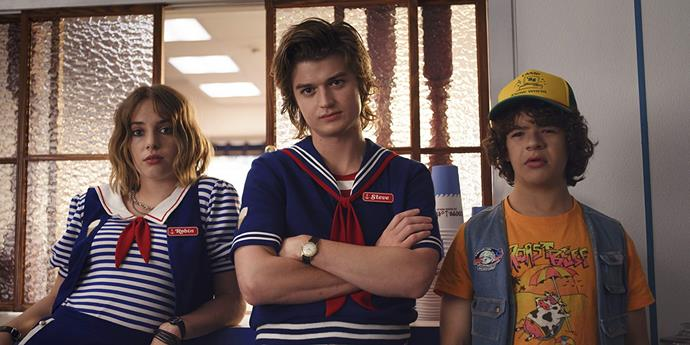 **2. The ice cream uniforms from *Stranger Things* 3** <br><br> Apocalyptic scenarios aside, one of the most memorable parts of *Stranger Things*' third season involved Steve Harrington getting a job at Hawkins' local ice-creamery. Steve and Robin ended up wearing their questionable work uniforms for the majority of the season, channelling chaotic sailor vibes all the way.
