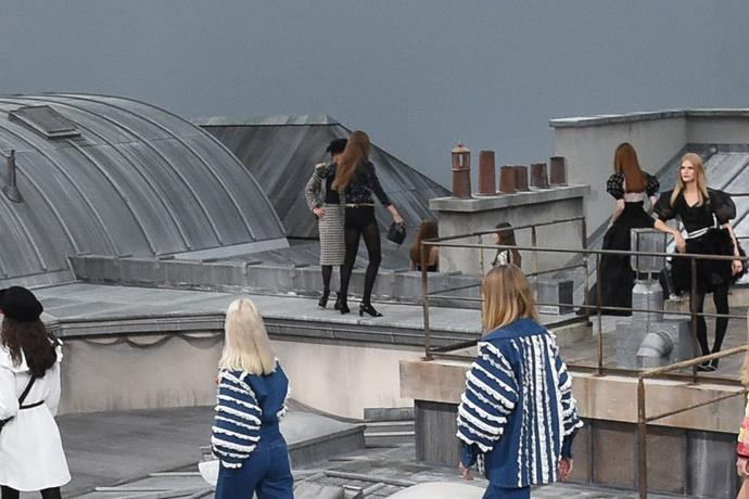 **3. Gigi Hadid pulling aside a catwalk intruder at Chanel spring/summer '20** <br><br> Whether or not you like to keep up with fashion shows, one particular fashion week instance definitely popped up on your feed—the moment when French YouTuber Marie S'Infiltre climbed onto the runway at Chanel's spring/summer '20 show, only to be forced off by a fed up-looking Gigi Hadid. Couple costume idea, anyone?