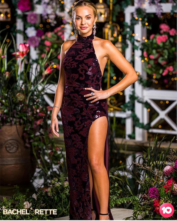 """Angie wears the 'Penelope' gown by Michael Costello x REVOLVE, $363.61 from [REVOLVE](https://www.revolveclothing.com.au/michael-costello-x-revolve-penelope-gown/dp/MELR-WD100/?d=Womens&page=2&lc=34&itrownum=12&itcurrpage=2&itview=01
