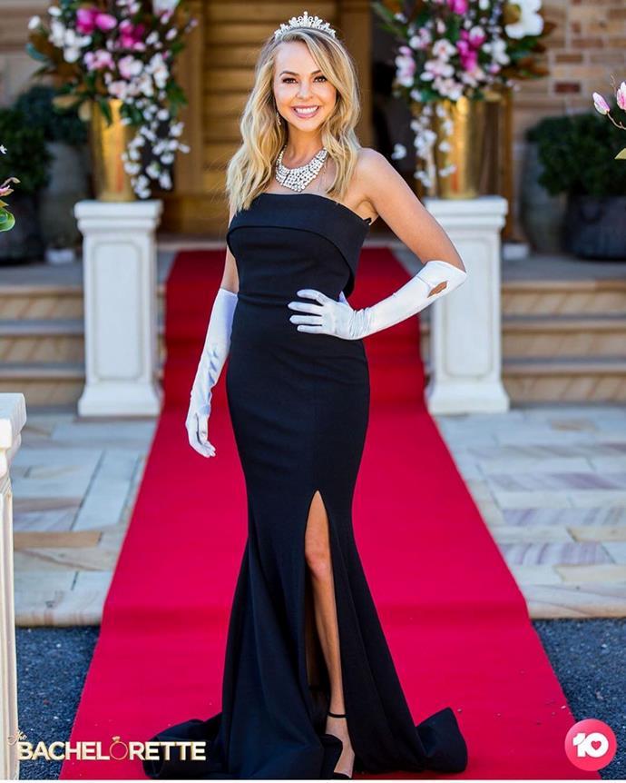 "Angie wears a strapless black dress by [Meraki Official](https://www.merakiofficial.com.au/|target=""_blank""|rel=""nofollow"") in episode eight."