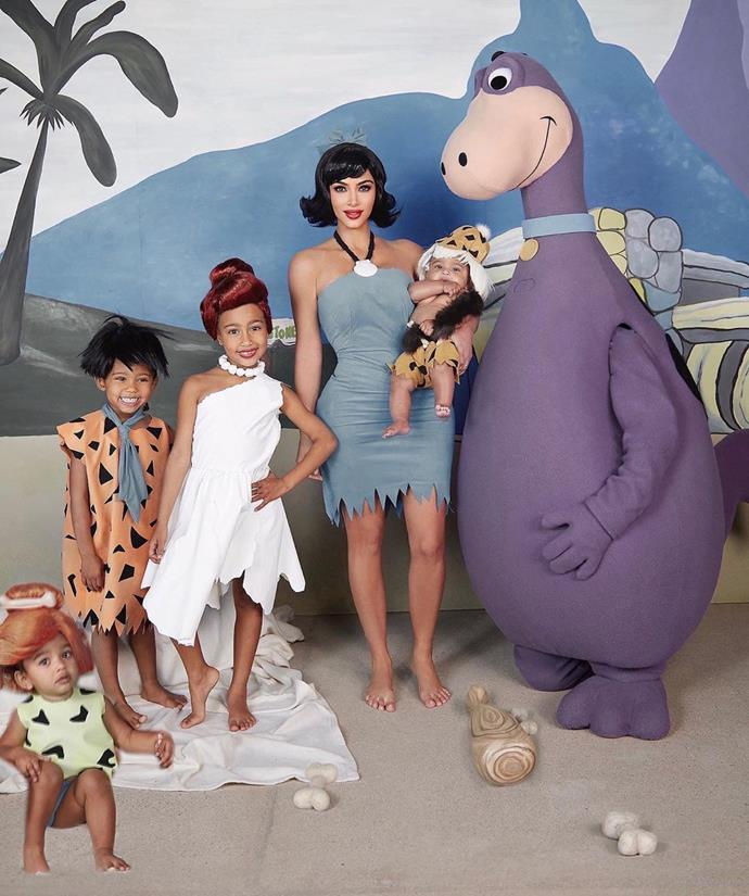 Kim Kardashian and Kanye, North, Saint, Chicago and Psalm West as characters from *The Flintstones*.