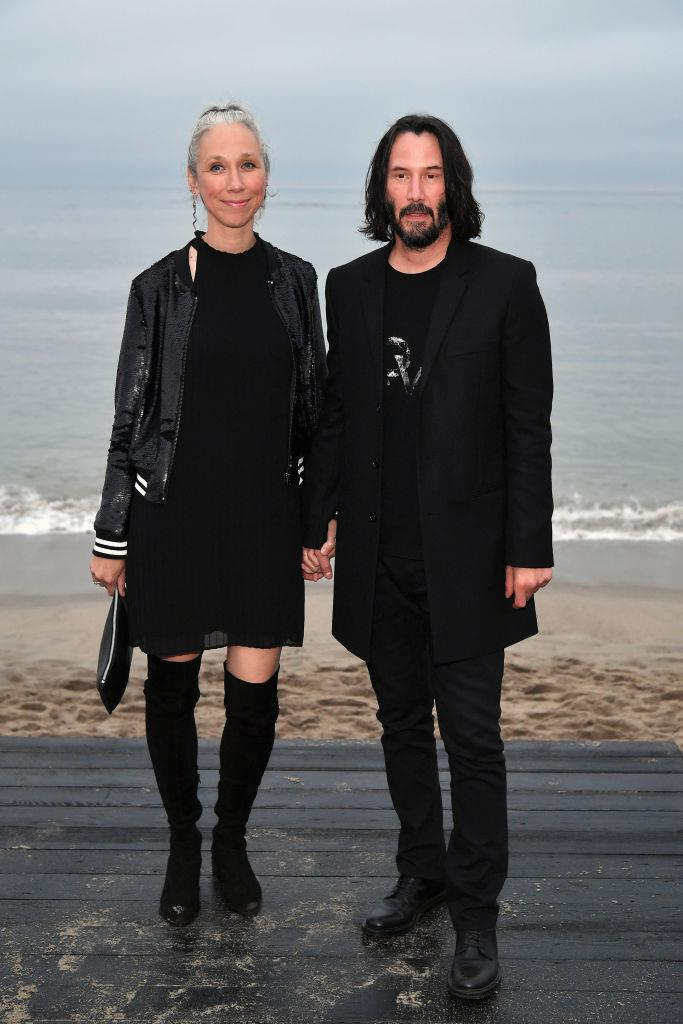 Reeves and Grant at Saint Laurent's menswear spring/summer '20 show in Malibu, June 2019.