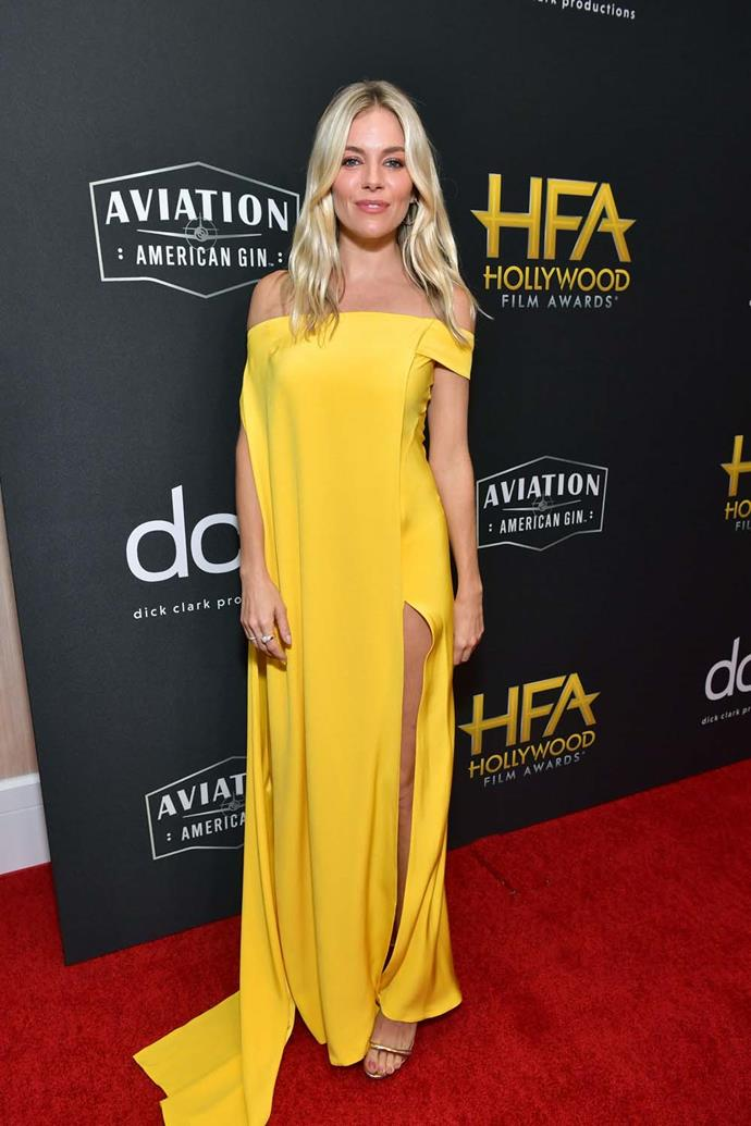 In a yellow Cong Tri gown.