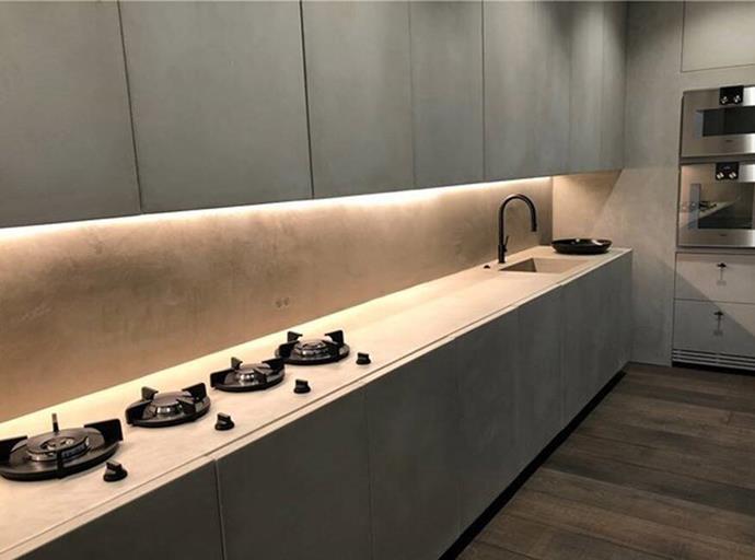The kitchen, featuring minimalist black stovetops.