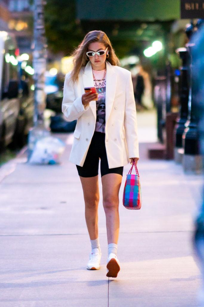 **Gigi Hadid**<br><br>  A '90s look through-and-through, Gigi Hadid's blazer-bike shorts combination (finished with the equally '90s sneakers and pulled-up socks) from August 2019 is a winner in our books.