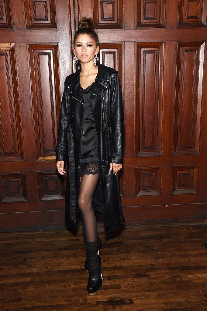 **Zendaya**<br><br>  Another one to mix multiple '90s trends at once? Zendaya. The *Euphoria* star was seen at Marc Jacobs' spring 2020 runway show wearing a lacy slip (check!) with a long leather coat (check!). Perfection.