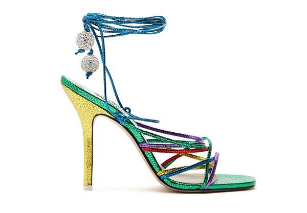 "Sandas by Attico, $1,027.95 at [Net-a-Porter](https://www.net-a-porter.com/au/en/product/1183841/Attico/eve-crystal-embellished-metallic-lizard-effect-leather-sandals|target=""_blank""|rel=""nofollow"")"