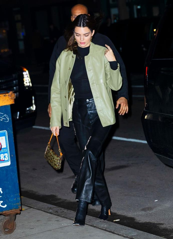 In November 2019, Jenner stepped out wearing a rare vintage Louis Vuitton 'Pochette' bag. The green crayon-style print debuted on the runway in the early 2000s, instantly becoming one of the label's first 'It-bags' of the 21st century. <br><br> *Image: Getty*