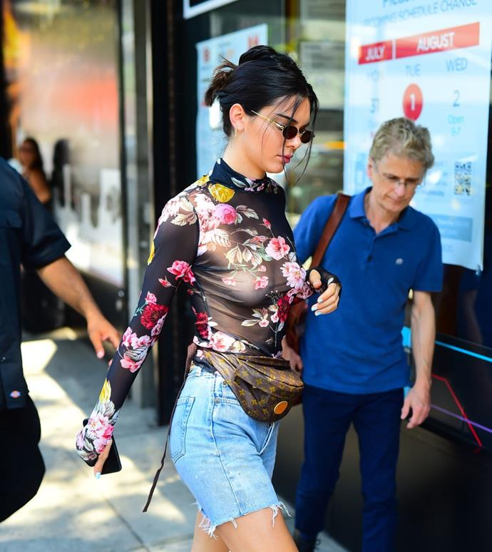 Jenner wore this vintage belt bag by Louis Vuitton in July 2017, with thin sunglasses and a pair of cut-off denim shorts adding to the '90s vibe. <br><br> *Image: Getty*