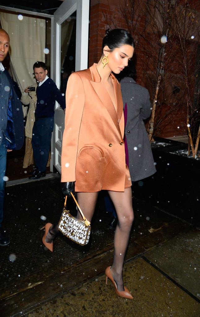 Like a true vintage fan, Jenner owns the bag in more than one colour—wearing a white-print version to a different event in New York in February 2019. <br><br> *Image: Getty*