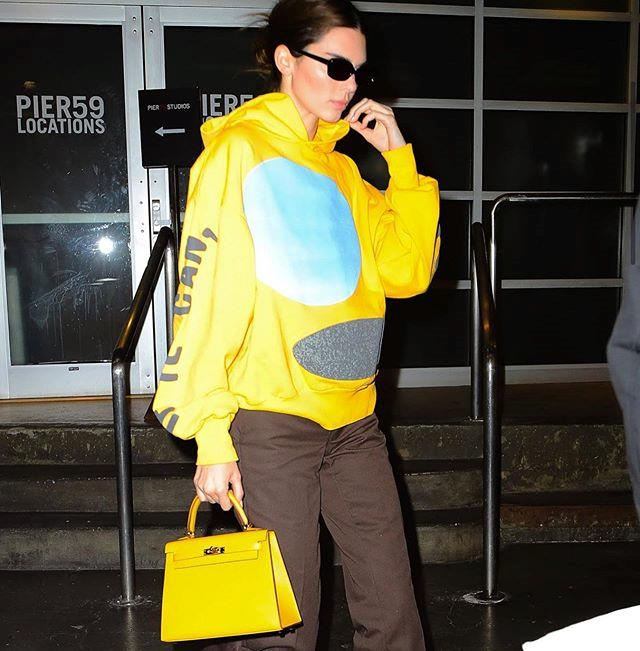 """As only she could, Jenner made a $15,000 vintage Hermès 'Kelly' handbag look streetwear appropriate during an outing in November 2019. <br><br> *Image: Instagram [@inspo.map](https://www.instagram.com/p/B5GGrRSg0Tz/