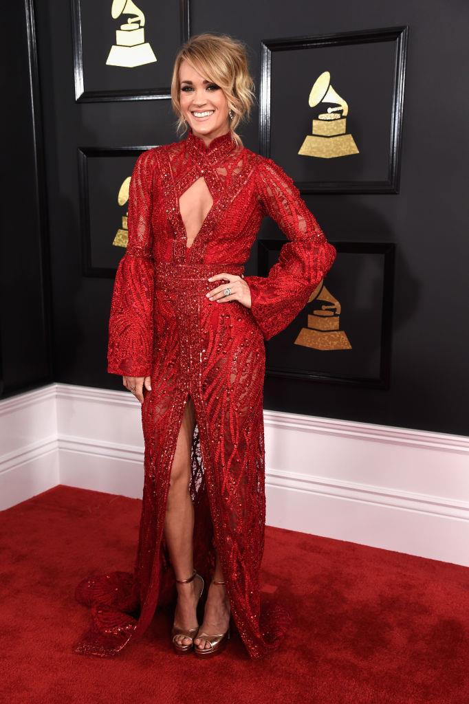 In a red Elie Madi cut-out dress at the Grammy Awards in February 2017. <br><br> *Image: Getty*