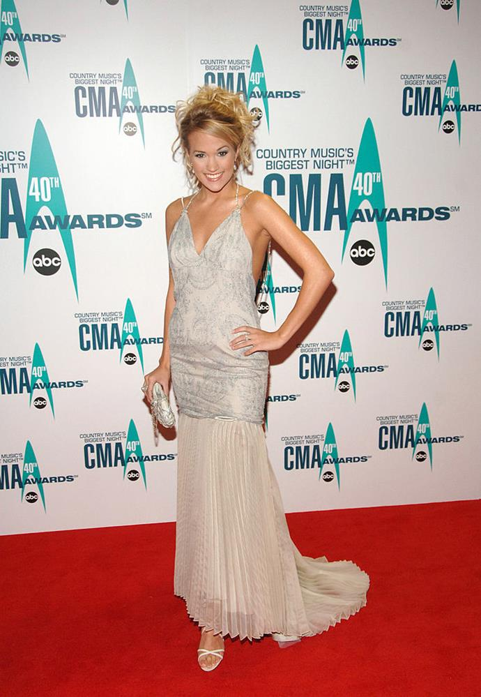 ***Carrie Underwood*** <br><br> Since winning the fourth season of American Idol in 2005, Carrie Underwood's style has progressed in leaps. Once a fan of big hair and typically '00s dresses, Underwood's fashion aesthetic has since been elevated a few notches—albeit, with the same level of razzle dazzle you'd expect from any country singer. <br><br> Pictured: In a spaghetti-strap pleated dress at the Country Music Awards in November 2006. <br><br> *Image: Getty*