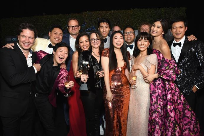 The cast of 2018's *Crazy Rich Asians*, including Constance Wu, Awkwafina, Gemma Chan, Michelle Yeoh and Ken Jeong.